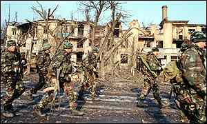 Russian soldiers search house-to-house