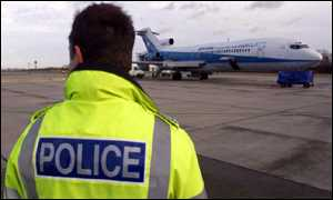 Policeman watches the plane