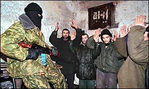 A Russian soldier guards suspected Chechen rebels