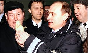 Vladimir Putin with a duckling