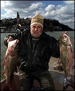 A boatman with dead fish in Danube River, Belgrade