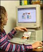 Woman using Tesco website