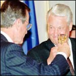 [ image: Boris Yeltsin shares a drink with George Bush in June 1992]