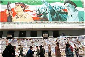 Tehran billboard with election flyers
