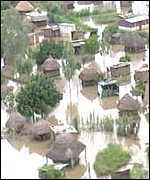 Huts stranded by Mozambique floods