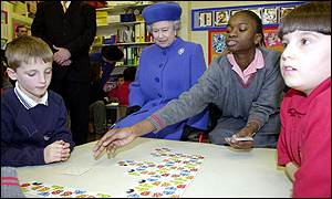 The Queen watches children playing