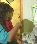 mother and young boy using computer at home