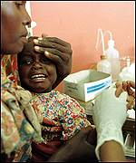 Testing a child for Malaria
