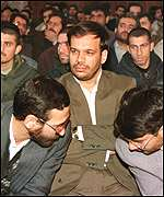 Brig Nazari sits between his two lawyers in court