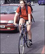 Cyclist braves the traffic in central London