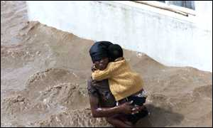 woman and baby in flood