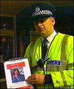 Police officer with poster