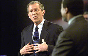 Bush denies bigotry, third candidate Alan Keyes looks on