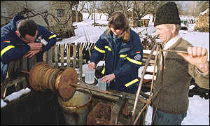A Romanian farmer provides water samples from his well