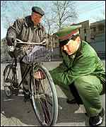 Soldier mending bicycle