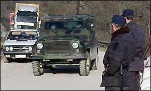 Serbian police patrol a road on the border with Kosovo