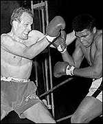 Henry Cooper fights Muhammad Ali in 1966