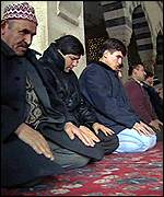 Turks pray at the Kocatepe Mosque in Ankara