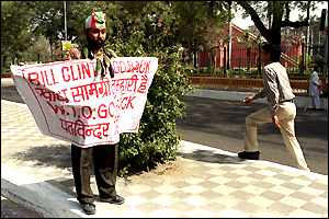 An Indian demonstrator holds up a banner