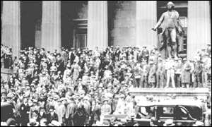 People gather across the street from the New York stock exchange 24 October 1929