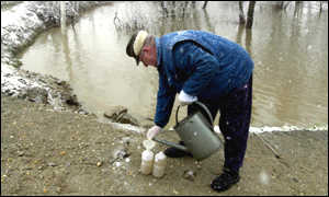 A dyke-keeper performs hourly tests on the river Tisza