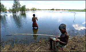 Boys fishing in flooded field near Chokwe