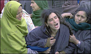 Grieving villagers in Kashmir