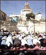 Muslims pray at site of planned mosque in Nazareth