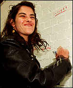 Tracey Emin signs the wall of the revamped gallery