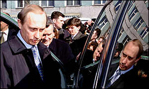 Vladimir Putin with his face reflected in a car window