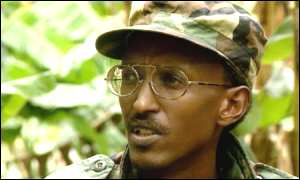 Photograph of a young Paul Kagame in army camoflage.