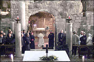 The Pope prays in the grotto