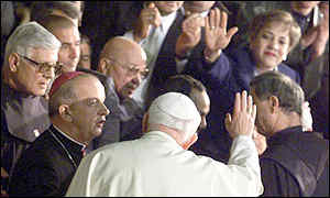Pope waves to worshippers