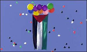 Palestinan flag and balloons in flag's colours