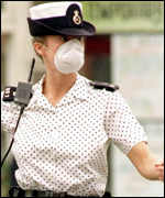 Police woman with anti-fume mask