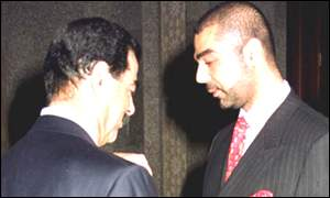 Saddam Hussein with eldest son Uday