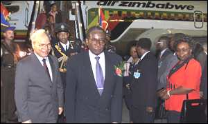 President  Mugabe arrives in Cairo