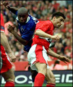 [ image: Frank Sinclair heads home Chelsea's first]