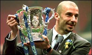 image: [ Chelsea's manager Gianluca Vialli holds the silverware ]