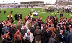 image: [ The Grand National crowds were evacuated onto the course during last year's IRA bomb hoax ]