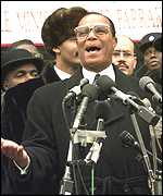 [ image: Aziz reports to Louis Farrakhan]