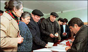 image: [ Armenians at a polling station near the capital, Yerevan ]