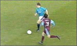 image: [ Kinkladze on his way to scoring a spectacular goal against West Ham in this season's FA Cup ]
