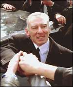 [ image: Reggie Kray greets well wishers at his brother's funeral]
