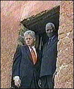 Clinton and Senegalese President Abdou Diouf visiting a slaves' prison