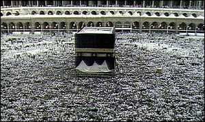 image: [ Pigrims surround the Kaba'a in Mecca ]