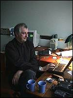 [ image: Douglas Adams at work at Digital Village]