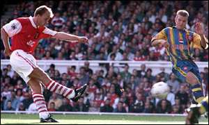 image: [ Bergkamp in action for double-chasing Arsenal ]