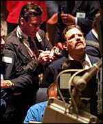 Market traders scarmble on the trading floor