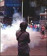 Police fire tear gas at an opposition rally
